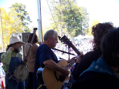 Ted Warmbrandt John Fromer amp Anne Feeney sing at the SOA
